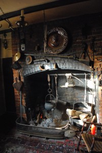 The historic house at 517 Prince St. has a massive wood-fired hearth that owner Joe Reeder keeps crackling. (Derrick Perkins)