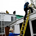 After Sandy lifted the roof of a home on Pierpont, friends and neighbors pitch in to help salvage furniture and personal items. (Susan Braun)